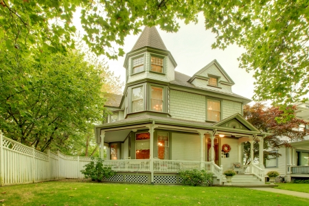 Beautiful historical grey craftsman American house exterior. with porch and towers Northwest. photo