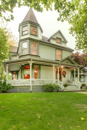 front porch: Beautiful historical grey American house exterior. with porch and towers Northwest.