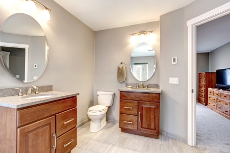 Beautiful grey new modern bathroom interior with two separate sinks. Banco de Imagens