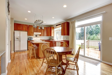 furnished apartments: Classic large wood kitchen interior with hardwood floor, breakfast table.