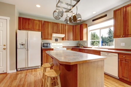 Classic large wood kitchen interior with hardwood floor, breakfast table. photo