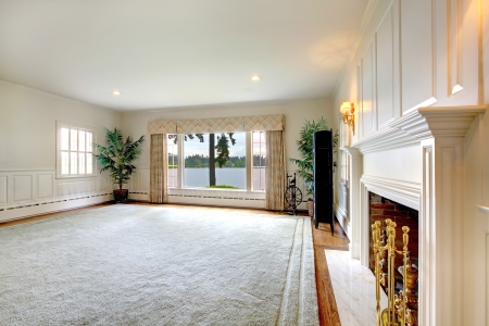 emty: Large empty historical old living room interior with fireplace and lake view. Stock Photo