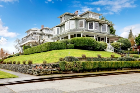 real estate house: Large luxury green craftsman classic American house exterior  Stock Photo