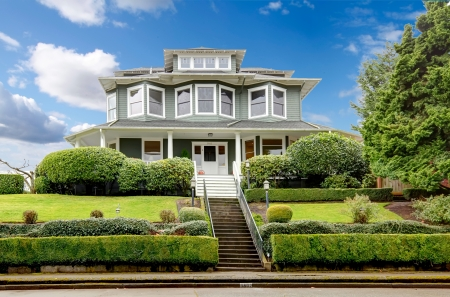 white trim: Large luxury green craftsman classic American house exterior  Stock Photo