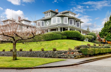 luxury house: Large luxury green craftsman classic American house exterior. Stock Photo