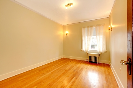 apartment: Empty room in an old apartment with beautiful hardwood. Stock Photo