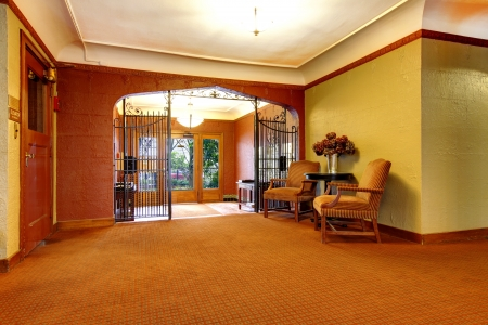 Old apartment building main foyer front door entrance. Stock Photo - 20992914