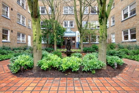 apartment: City apartment building main front yard with spring landscape.