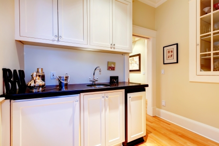 stainless: White cabinets of space between kitchen and dindng room - serving room. Stock Photo