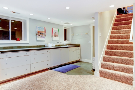Baseent with staircase, white cabinets for storage. Stock Photo - 20992965