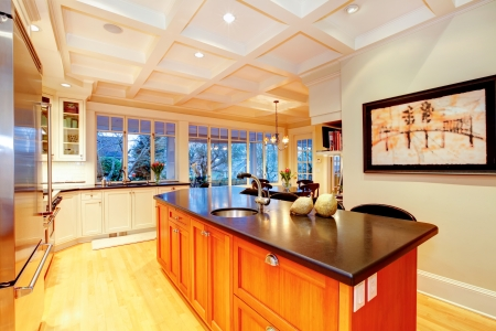 ceiling: White large luxury kitchen with huge wood island and white wood ceiling. Stock Photo