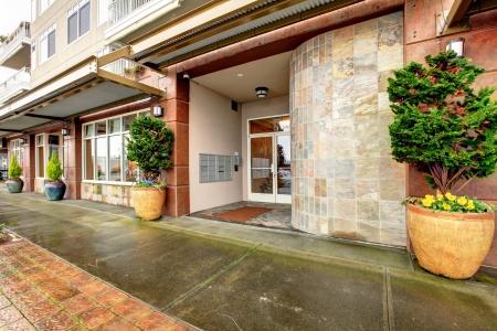 apartment: City modern apartment building entrance. Exterior.  Stock Photo