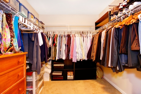 Bachelor closet interior with lots of busines clothes.