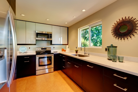 Modern kitchen with white countertops, white and brown new cabinets. photo