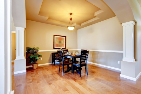 New home dining room interior with hardwood floors and table. photo