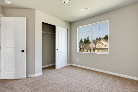 New empty room with beige carpet.. New house development in USA. Stock Photo - 21728640