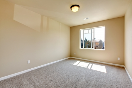 Carpet floor: New empty room with beige carpet.. New house development in USA. Stock Photo