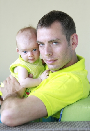 Young father is holding baby girl  Stock Photo - 21728936