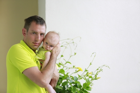 Young father is holding baby girl  Stock Photo - 21728938