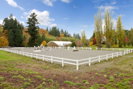 Northwest horse rach with fall changing leaves and white fence. Stock Photo - 23131495