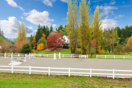 Northwest horse rach with fall changing leaves and white fence. Stock Photo - 23131496