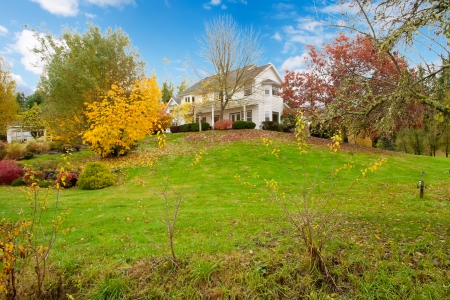 Northwest horse ranch white house with fall changing leaves and white fence. Stock Photo - 22285348