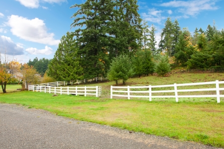 Northwest horse rach with fall changing leaves and white fence. Stock Photo - 22285353