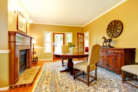 LIving room with fireplace, mustard wall color and beautiful rug. Stock Photo - 25147725
