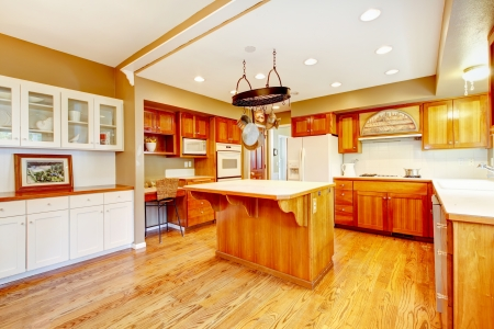 Country American farm house kitchen with fall views. Large room with hardwood floor, kitchen island and breakfast area.