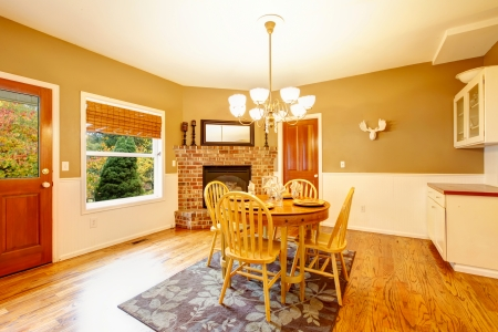 American farm house breakfast dining room area with brick fireplace. Stock Photo - 25147747