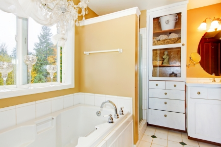 Bathroom with large white tub and storage cabinet. Stock Photo - 25147751