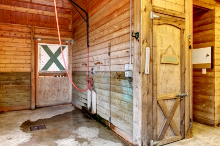 Large horse farm stable interiors. Stock Photo - 25147760
