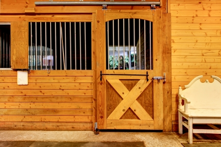 horse stable: Large horse farm stable interiors.
