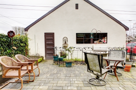 old town house: Backyard of a cute old town house with table and chairs