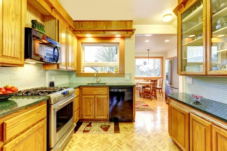 Cozy classic kitchen with wood brown cabinets and modern appliances