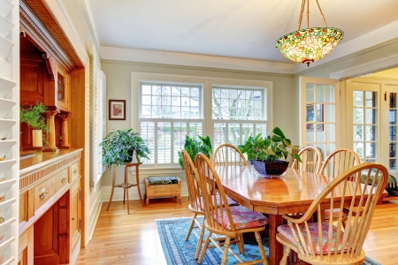 nice house: Big classic light living room with brown dinner table set and storage combination