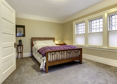 Classic bedroom with brown queen size bed, beige walls and white ceiling Stock Photo - 25160195
