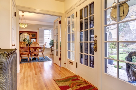 glass doors: Hallway with glass white doors and hardwood floor