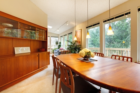 Cute dining room with wooden brown table set and storage combination photo