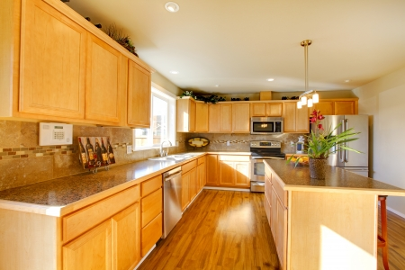 rearrange: Big kitchen room with wooden cabinets and steel appliances