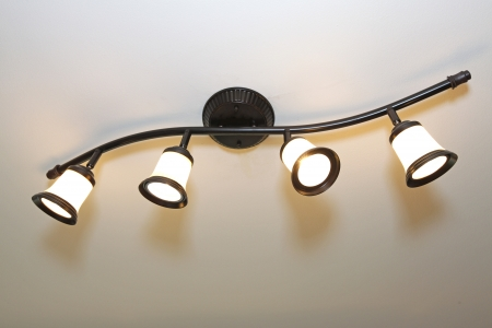 Black iron chandilier with four light bulbs Stock Photo - 25190418