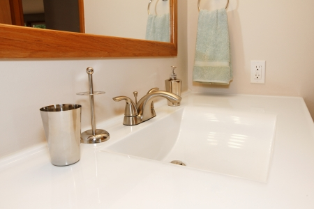 White modern large sing with goldish faucet set photo