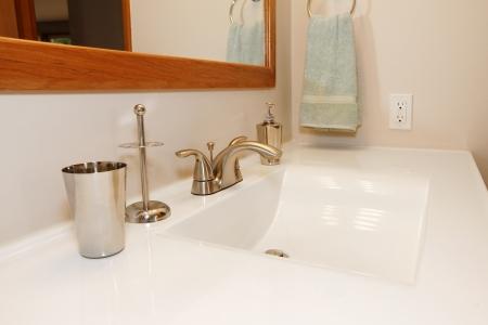 goldish: White modern large sing with goldish faucet set Stock Photo