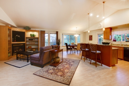counter top: Spacious comfortable living room extended to the kitchen with a dining area