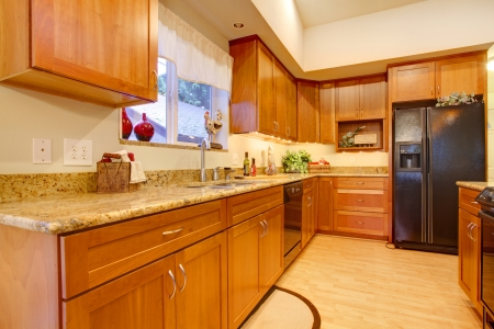 clean room: Bright kitchen room with wooden cabinets and hardwood floor