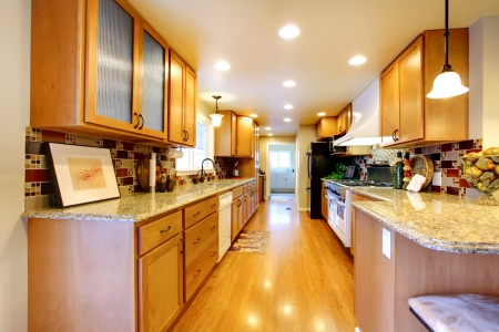 wood ceiling: Bright kitchen room with wooden cabinets and hardwood floor