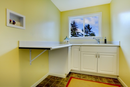 Empty yellow laundry room Stock Photo - 25356444