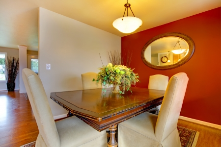 Small elegant dining corner room with a beautiful dining table set  Great contrast colors solution for walls photo