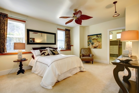Luxuriant bright bedroom with contrast dark brown wooden furniture photo