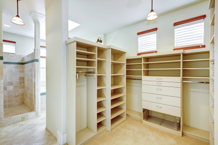 Walk-in closet and shower combined in a big bright bathroom Stock Photo